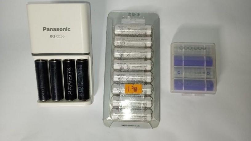 nikon-18-140-35-56-g-ed-vr-with-marumi-67mm-uv-haze-filter-and-2-caps-big-0